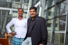 Dr. Ifeoma Nwogu and Dr. Venu Govindaraju of the Center for Unified Biometrics and Sensors (CUBS) in Davis Hall, 2012. Photo credit: Douglas Levere