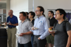 CSE faculty look on at the CSE50 Kickoff Event in Davis Hall. Jan Chomicki, Jaric Zola, Dimitrios Koutsonikolas, Mingchen Gao, Oliver Kennedy, Andrew Hughes, Shi Li.