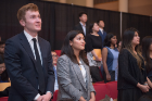 Connor Mulqueen (CS BS '18), Liesel Vaidya (CS BS '18), and Aishani Bhalla (CS BS '18, CS CERT '18) rise to recite the Pledge of the Computing Professional oath, February 20, 2018. Photo credit: Onion Studio