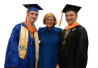 SUNY Chancellor's Awards for Student Excellence winners Steven J. Coffed, BS in mechanical and aerospace engineering, (left) and Timothy Van Oss, MS in civil engineering, (right) pose for a photo with Dean Liesl Folks before the 2016 SEAS commencement ceremony. Missing from the photo is Mingcong Zhang, BS in computer science.