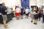 Students touring the UB machine shop.