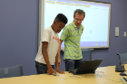 Philip Kilinskas, a research scientist in the CUBS lab of the Department of Computer Science and Engineering, gave a fingerprint identification demo. Students were invited to scan the same fingerprint twice to see how the software could identify the common features between the two scans.