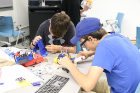 Teams built their robots from kits and 3D printed components, connecting together components, soldering wires, and designing custom components.