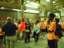 National Grid representative giving students a tour of their facilities.