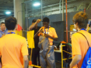 Students getting some hands-on experience with safety equipment at National Grid.