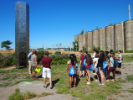 Students gather at Elevator B, a honeycomb-themed tower designed to house bees at Silo City.