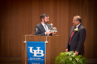 Jordan Walbesser presents Ashish Shah with the Engineer of the Year award.