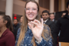 A student at the Order of the Engineer Induction Ceremony shows off the stainless steel ring, which symbolizes her dedication to upholding the standards and dignity of the engineering profession.