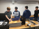 Team members working on design during a weekly meeting in Bell Hall. From left are Joshua Duell, Kevin Zheng, Ryan Hughes and Imon Tatar.