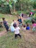 Community member Nelson Picado and EWB's Evan Supple explain surveying to the children of La Laguna.