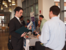 Students speaking with corporate representatives at the talent fair.