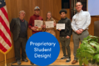A student team receives an award for their EAS 199 design project.