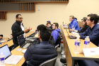 A faculty mentor meets with students during a EAS 199 class.