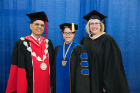 Ann Wegrzyn (BS IE '85; MBA '90) received the Dean's Award from the School of Engineering and Applied Sciences. She is shown with (from left) Satish Tripathi, UB president, and Ann Bisantz, professor and chair of the Department of Industrial and Systems Engineering. Photo credit: The Onion Studio.