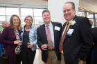 Cindi Hoover, Liesl Folks, Chris Hanley and Robert Hanley Jr. smile for a photo at the awards night reception.