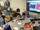 A high school student works on fine tuning his robot hardware a following a test run.