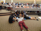Group of students sprawled out on the floor of 101 Davis.