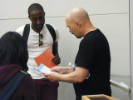 Students receiving resume advice from Zwolinski (right).
