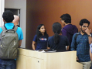 Chaudhari (center) answering student questions after the conclusion of the Resume Workshop.