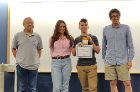 Nathan Margaglio earned first place in the Reinforcement Learning Challenge. From left is Wen Dong (CSE faculty member and judge), Nathan Margaglio, Alina Vereshchaka (organizer) and Kenny Joseph (CSE faculty member and judge).