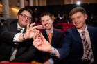Students at the Order of the Engineer Induction Ceremony show off the stainless steel ring, which symbolizes their dedication to upholding the standards and dignity of the engineering profession.