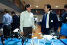 Eric Petrie, the CEO of Skylink Drones, talks about the environmental surveillance services provided by their company with Zhangyu Guan, one of the organizers of the Buffalo Wireless Day event.