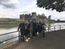 Students in front of Caerphilly Castle, a medieval fortification in Caerphilly in South Wales. The visit was part of UB's School of Engineering and Applied Sciences - Swansea Study Abroad program.