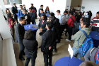 Shrivardhan Joshi (left), environment, health and safety manager at Tesla, Inc. and UB industrial engineering alumnus, talks to students during the Career Preparation Reception.