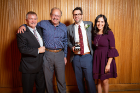 From left, Andrew Whittaker, Michael Constantinou, Dan Fenz and Abigail Martinez-Fenz celebrate Dan's Outstanding Young Alumnus award.
