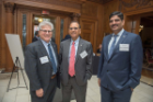 UB President Tripathi with two others at the Butler Mansion.