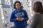 PhD student Premjit Saha discussing his poster with Dr. Minghui Zheng