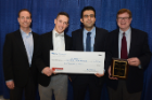 Taking second place was Shay Bioproducts. Accepting the award, were, from left, Blaine Pfeifer, associate professor of chemical and biological engineering, and doctoral students Charles Jones, Mahmoud Kamal Ahmadi. Robert Kosobucki, far right, from Insyte Consulting coached the team. Photo: Nancy J. Parisi