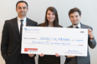 Showing off their check for the first-place win were, from left, Thiru Vikram, Emilie Reynolds and Alexander Zhitelzeyf. Photo: Nancy J. Parisi