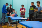 Participants line up for quadcopter racing, in which students guide their mini-drones through a perilous course.