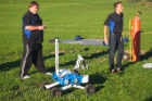 From left: Graduate students Kyle Thompson, electrical engineering, and Livio Forte III, mechanical and aerospace engineering, get the remote-controlled rover ready for a demonstration.
