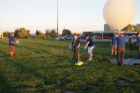 Students will track the balloon by downlinking its GPS position to the ground over a radio.