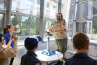 Mark Shotwell, an audio engineer at the Center for the Arts and a leader with Cub Scout Pack 286 in Tonawanda, has a hair-raising experience with a Van de Graaff generator in Davis Hall.