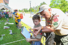 Aaron Belanger, 10, from Cub Scout Pack 272 in Cheektowaga, learns about best camping practices from Fred Thornley, East Aurora Pack 513.