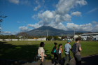 The Miravalles volcano looms in the distance as the students walk to the geothermal plant where the electricity for the entire country is managed.