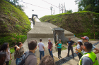 Students tour the Los Negros hydroelectric plant and pass a religious statue along the way.