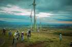Students tour the turbines at the Celsia wind farm in Guanacaste.