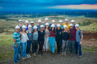 "Members of John Atkinson's course, ""Costa Rica: Sustainability in Latin America,"" pose for a picture with the Celsia wind project turbines in the background."