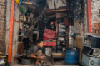 A boy working inside an e-waste recycling shop. Child labor is very frequent in this industry, Aich says.