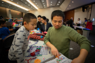 Han, age 5, and dad Xiang Zhang get down to business with some Snap Circuits.