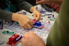 Snap Circuits uses color-coded pieces so kids can experiment with lights, fans, sound and other circuits found in everyday electronics.