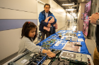 Claire, 4, and her dad, biomedical engineering professor Rougang Zhao, look at computer parts.