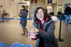 Lisa Hu, a senior mechanical and aerospace engineering major, shows off her egg after a successful drop.