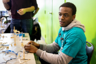 Judge Osazuwa Eghafona, a sophomore chemical engineering major, tests and scores a pulley. This one could pinch/grasp to pick things up, which earned it high marks.