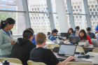 Students in action at the 2019 Blockchain Buildathon.