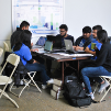 A group of students work on a solution during the Blockchain Buildathon.
